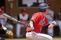 Miles Hamblin #24 of the Ole Miss Rebels follows through on his swing against the St. John's Red Storm at the Charlottesville Regional of the 2010 College World Series at Davenport Field on June 6, 2010, in Charlottesville, Virginia.  The Red Storm defeated the Rebels 20-16.  Photo by Brian Westerholt / Four Seam Images