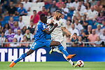 Karim Benzema (R) of Real Madrid fights for the ball with Dakonam Ortega Djene of Getafe CF during the La Liga 2018-19 match between Real Madrid and Getafe CF at Estadio Santiago Bernabeu on August 19 2018 in Madrid, Spain. Photo by Diego Souto / Power Sport Images