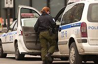 Montreal Policemen and policewomen wear some civilian clothes to protest work conditions, May 3, 2003<br /> Copyright  : 2003 Images Distribution