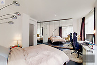 BNPS.co.uk (01202) 558833. <br /> Pic: OrlandoReid/BNPS<br /> <br /> Pictured: Bedroom. <br /> <br /> A flat in a ten-storey Art Deco mansion block that was the fictional home of TV detective Hercule Poirot has gone up for rent for £1,950 a month.<br /> <br /> Grade II listed Florin Court in East London was used for filming the long-running ITV series about Agatha Christie's iconic detective.<br /> <br /> The one-bedroom ground floor flat includes a double bedroom, an open plan reception room and kitchen, and a study or home office and<br /> a marble-tiled family bathroom.<br /> <br /> The exterior of the building has strong Art Deco motifs, many of which were used in the filming of Poirot, for 24 years, from 1989 to 2013.
