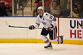 December 30th, 2007:   Mark Manacri (26) of the Rochester Amerks chases down the puck during the first period of play.  The Syracuse Crunch shutout the Rochester Amerks 4-0 to earn the win at Blue Cross Arena at the War Memorial in Rochester, NY.  Photo Copyright Mike Janes Photography 2007.