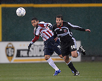 DC United midfieder Ben Olsen (14) fights for possession of the ball with CD Guadalajara Ramon Morales (11) in the rain during the first leg of the 2007 CONCACAF Champions' Cup Semifinal match between DC United and CD Chivas from Guadalajara, DC United tied Chivas 1-1 on March 15, 2007 at RFK Stadium in Washington DC.
