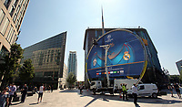 Pictured: Workers secure a giant UEFA Champions League banner outside St Davids Centre the Library building in The Hayes, Cardiff. Thursday 25 May 2017<br />
