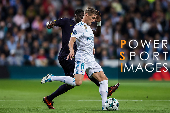Toni Kroos of Real Madrid (front) fights for the ball with Moussa Sissoko of Tottenham Hotspur FC (back) during the UEFA Champions League 2017-18 match between Real Madrid and Tottenham Hotspur FC at Estadio Santiago Bernabeu on 17 October 2017 in Madrid, Spain. Photo by Diego Gonzalez / Power Sport Images