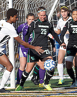 Corner kick: Wilmington University defender Monica Weil (25) works to clear ball.. In 2012 NCAA Division II Women's Soccer Championship Tournament First Round, College of St Rose (white) defeated Wilmington University (black), 3-0, on Ronald J. Abdow Field at American International College on November 9, 2012.