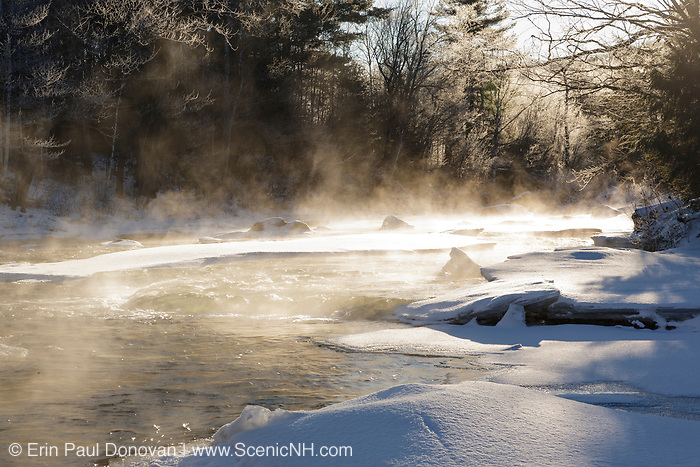 The snow-covered Ammonoosuc River in Carroll, New Hampshire during the winter months.