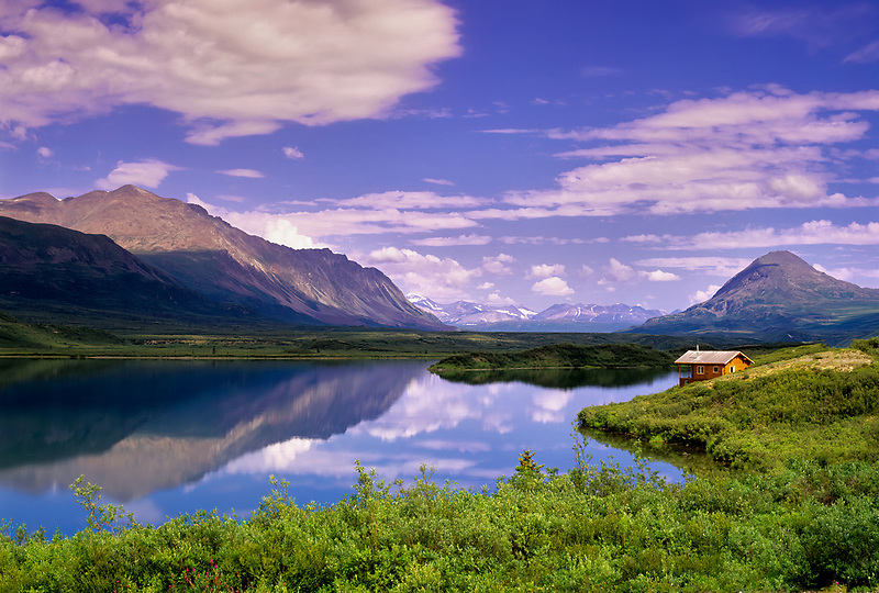 Cabin and reflection in Tangle Lake, Alaska