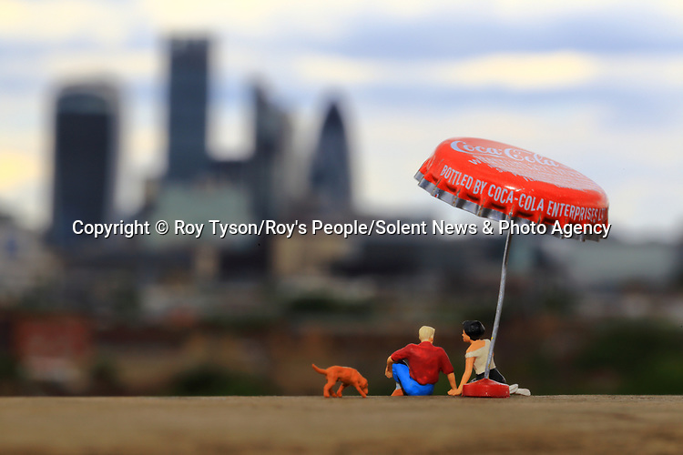 Pictured: City Dreaming<br /> <br /> Tiny figurines give a new perspective on everyday objects as they are posed interacting with them in their miniature world.  Artist Roy Tyson creates witty and intriguing imagery with customised miniature figures, under the name Roy's People.<br /> <br /> Since 2012, he has been photographing his miniature world on the streets of London and beyond.  SEE OUR COPY FOR DETAILS.<br /> <br /> Please byline: Roy Tyson/Roy's People/Solent News<br /> <br /> © Roy Tyson/Roy's People/Solent News & Photo Agency<br /> UK +44 (0) 2380 458800