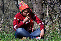 Pictured: A young migrant rests on the hard shoulder Thursday 25 February 2016<br />Re: Hundreds of migrants, including families with young children, that were stranded at Tempe in central Greece, were forced to walk on foot on the motorway to reach Idomen, about 168 kilometres away, in the northern part of the country, at the Greek FYRO Macedonian border. Local police were at first escorting them, then made sure that they were safely transported on coaches.