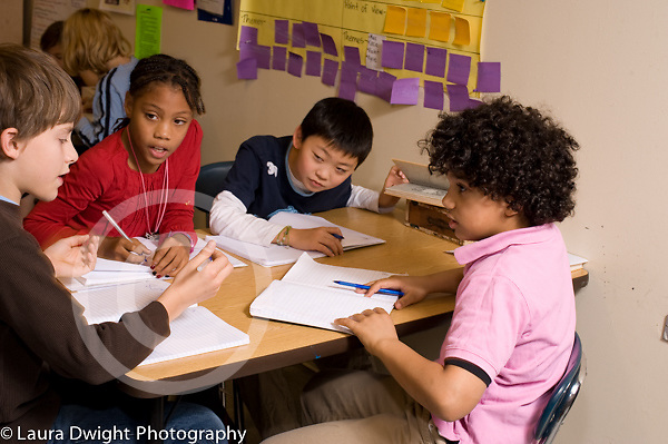 Education Elementary Grade 4 group of one girl and 3 boys talking discussion