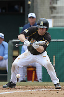Brannon Champagne, #6, of the Missouri Tigers bunts against the North Carolina Tar Heels at Dedeaux Field on February 20, 2011 in Los Angeles,California. Photo by Larry Goren/Four Seam Images