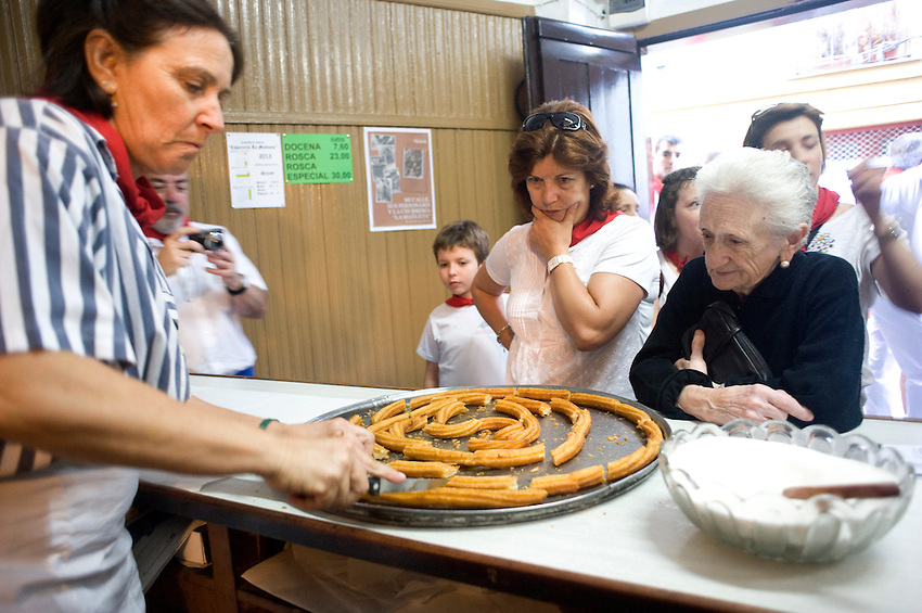 Elizabeth-Fernandez family members work at the Churreria La Mañueta on July 9, 2013, in Iruña-Pamplona, Basque Country. The churreria Mañueta exists since December 13, 1872. Five generations of the family Elizabeth-Fernández has worked on the Mañueta churrería since 1872. During San Fermin Festival is an old tradition to eat 'churros' in the morning before and after the running of the bulls. Mañueta opens its doors for the last two Saturdays of June, the festival of San Fermin and all Sundays in October. (Ander Gillenea / Bostok Photo)