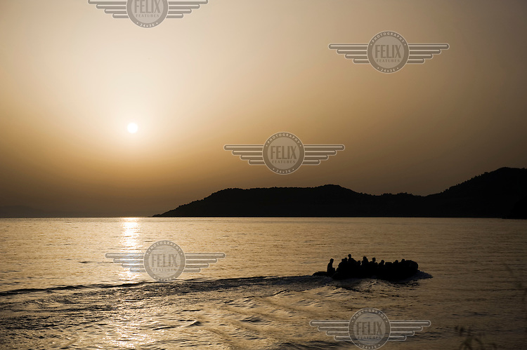 A small inflatable boat with more than 40 Afghan refugees is seen off the coast of the Greek island of Lesbos minutes before landing on the beach of Skala Sykaminias. Every day hundreds of refugees, mainly from Syria and Afghanistan, are crossing in small overcrowded inflatable boats the 6 mile channel from the Turkish coast to the island of Lesbos in Greece. Many spend their life savings, over $1,000, to buy a space on these boats.