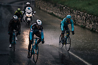 Omar Fraile (ESP/Astana) making a splash; torrential rain makes manouvering in the descents extremely tricky (with water even coming out of the putholes)<br /> <br /> 76th Paris-Nice 2018<br /> Stage 8: Nice > Nice (110km)