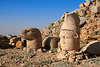Statue heads, from right,  Antiochus & Eagle  in front of the stone pyramid 62 BC Royal Tomb of King Antiochus I Theos of Commagene, east Terrace, Mount Nemrut or Nemrud Dagi summit, near Adıyaman, Turkey