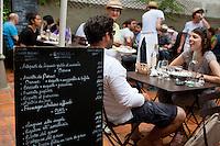 Diners in the garden of La Cantinetta restaurant, Cours Julien, Marseille 17 June 2011