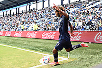 KANSAS CITY, KS - MAY 16: Gianluca Busio #10 Sporting KC takes a corner kick during a game between Vancouver Whitecaps and Sporting Kansas City at Children's Mercy Park on May 16, 2021 in Kansas City, Kansas.