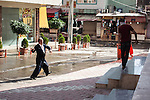 10/10/2015--Sulaimaniyah,Iraq-- An old man in Kurdish clothes is throwing a rock in defense against police forces.