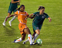 Sky Blue FC midfielder Rosana (11) and Saint Louis Athletica defender Kendall Fletcher (24) during a WPS match at Anheuser Busch Soccer Park, in St. Louis, MO, July 22 2009. Athletica won the match 1-0.