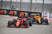 226th September 2021; Sochi, Russia; F1 Grand Prix of Russia, Race Day:  55 SAINZ Carlos epa, Scuderia Ferrari SF21  and 04 NORRIS Lando gbr, McLaren MCL35M as the fight it out for the lead mid-way in the race