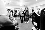 CHAD PILSTER •Hays Daily News<br /> <br /> LaVerna Herl, left, a resident, Bob Gottschalk, an employee, dance as Rosie Dinkel plays the saxophone and Norma Weimer plays the accordion on Thursday, October 17, 2013 as polka music is played by the Wes Windholz Band at the Cedar View Assisted Living Residence in Hays, Kansas. The Wes Windholz Band plays the third Thursday of every month at area retirement homes.