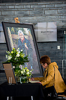 Thursday 18 May 2017<br /> Pictured: A woman signs the book of condolences which has been places inside the 'Senedd', the Welsh Assembly Building in Cardiff Bay <br /> Re: Former Welsh first minister Rhodri Morgan has died, aged 77. Rhodri Morgan was elected as an MP in 1987 and became an AM when the assembly was created in 1999.
