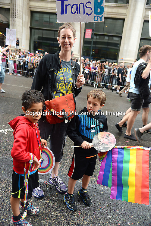 mom her trans son attend the 2015 New York City Pride March on June 28, 2015 on Fifth Avenue in New York City. <br /> <br /> photo by Robin Platzer/Twin Images<br />  <br /> phone number 212-935-0770