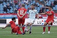 6th June 2021, Stade Josy Barthel, Luxemburg; International football friendly Luxemburg versus Scotland;  Mica Pinto and Laurent Jans of Luxembourg taken on by Stephen ODonnell Scotland