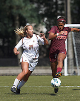 Virginia Tech midfielder Candace Cephers (18) clears the ball as Boston College forward Rachel Davitt (24) fails to control the ball.Virginia Tech (maroon) defeated Boston College (white), 1-0, at Newton Soccer Field, on September 22, 2013.