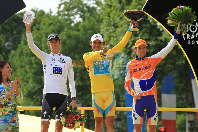 Alberto Contador (ESP) Astana overall winner, Andy Schleck (LUX) Saxo Bank 2nd place and Denis Menchov (RUS) Rabobank 3rd on the podium at the end of the final Stage 20 of the 2010 Tour de France running 102.5km from Longjumeau to Paris Champs-Elysees, France. 25th July 2010.<br /> (Photo by Eoin Clarke/NEWSFILE).<br /> All photos usage must carry mandatory copyright credit (© NEWSFILE | Eoin Clarke)