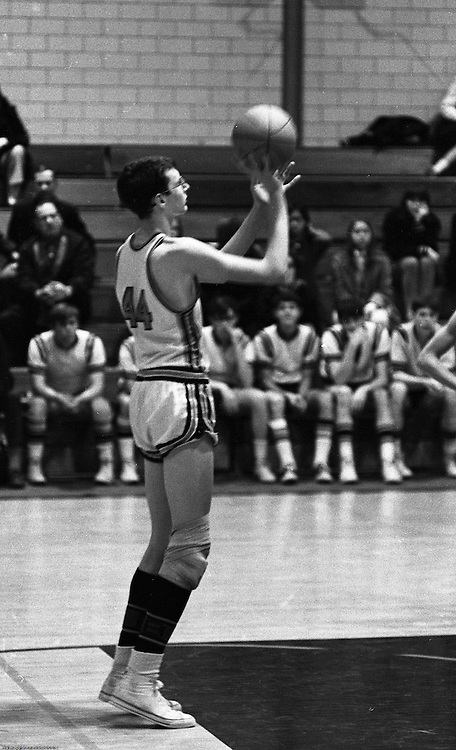 Bethel Park PA:  John Klein 44 shooting a foul shot during a basketball game against the Mt Lebanon Blue Devils at Bethel Park Gymnasium.  The JV Team was coached by Mr. Reno and the Bethel Park JVs won the Section Championship.  The team included; Scott Streiner, Steve Zemba, John Klein, Mike Stewart, Bruce Evanovich, Jeff Blosel, and Tim Sullivan.