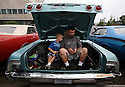Father and son attend the annual Dream Cruise along Woodward Ave. in Birmingham, MI.