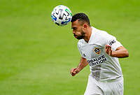 LOS ANGELES, CA - OCTOBER 25: Giancarlo Gonzalez #21 of the Los Angeles Galaxy heads a ball during a game between Los Angeles Galaxy and Los Angeles FC at Banc of California Stadium on October 25, 2020 in Los Angeles, California.