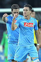 NAPLES, Italy - September 18, 2013: Napoli beats Borussia Dortmund 2-1 during the Champions League match in San Paolo Stadium. In the photo the celebration for the 1-0 goal