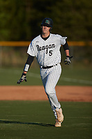 Reagan Raiders starting pitcher Josh Hartle (5) jogs off the field during the game against the Reynolds Demons at Ronald Wilson Reagan High School on May 11, 2021 in Pfafftown, North Carolina. (Brian Westerholt/Four Seam Images)