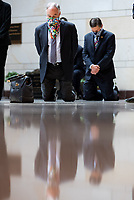 United States Senator Tim Kaine (Democrat of Virginia) kneels on the ground while the US Senate Democratic Caucus observes a moment of silence to commemorate the life of George Floyd, Ahmaud Arbery and Breonna Taylor and to stand in solidarity with Americans all across the country peacefully protesting racial injustice in the Emancipation Hall of the Capitol Visitor Center on Capitol Hill in Washington, District of Columbia on Thursday, June 4, 2020. <br /> Credit: Ting Shen / CNP/AdMedia