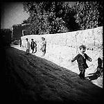 Children run through a village in Panjwayi district, Kandahar, 30 April 2013. (John D McHugh)