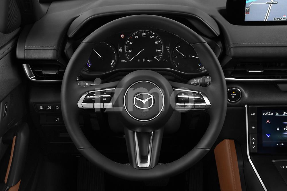 Car pictures of steering wheel view of a 2021 Mazda MX-30 Skycruise 5 Door SUV Steering Wheel
