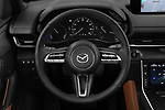 Car pictures of steering wheel view of a 2021 Mazda MX-30 Skycruise 5 Door SUV Steering Wheel