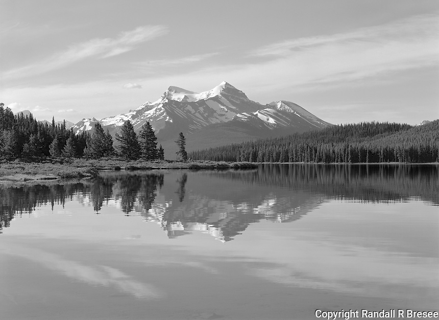 """""""Maligne Lake"""" <br /> Jasper National Park; Alberta, Canada<br /> <br /> Maligne Lake is a common stop for visitors to Jasper National Park. A boat ride or walk along the shore provides picturesque views in every direction. I made this photograph during a walk along the lake shore one fine afternoon. The photo captures the clean sky and terrain that is common in Jasper National Park."""