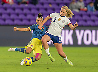 ORLANDO, FL - JANUARY 18: Kelly Ibarguen #2 of Colomba defends Lindsey Horan #9 of the USWNT during a game between Colombia and USWNT at Exploria Stadium on January 18, 2021 in Orlando, Florida.