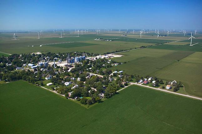Aerial view of wind farm near small town on the prairie