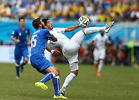 Luis Suarez of Uruguay controls the ball under pressure from Andrea Barzagli of Italy