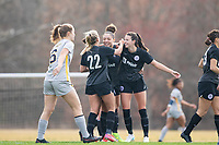 LOUISVILLE, KY - MARCH 13: Cece Kizer #5, Katie McClure #22 and Jorian Baucom #33 of Racing Louisville FC hug to celebrate a goal during a game between West Virginia University and Racing Louisville FC at Thurman Hutchins Park on March 13, 2021 in Louisville, Kentucky.