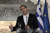 Pictured: Greek Prime Minister Alexis Tsipras during a joint press conference held at Maximou Mansion (Megaro Maximou) in Athens, Greece.<br /> Re: Official visit of German Chancellor Angela Merkel  to Athens, Greece.