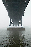 Available for Commercial and Editorial Licensing Exclusively from Corbis.<br /> <br /> Please search for image # 42-20926808 on www.corbis.com.<br /> <br /> Upward View of the Manhattan Bridge and the East River during a Snowstorm<br /> <br /> Lower Manhattan, New York City, New York State, USA