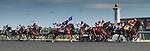 The field passes by the start-finish line at the 155th Queen's Plate at Woodbine Race Course in Toronto, Canada on July 06, 2014.