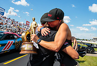 Sep 3, 2018; Clermont, IN, USA; NHRA factory stock driver Leah Pritchett celebrates with husband Gary Pritchett after winning the US Nationals at Lucas Oil Raceway. Mandatory Credit: Mark J. Rebilas-USA TODAY Sports