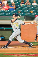Richie Shaffer (12) of the Montgomery Biscuits follows through on his swing against the Chattanooga Lookouts at AT&T Field on July 24, 2014 in Chattanooga, Tennessee.  The Biscuits defeated the Lookouts 6-4. (Brian Westerholt/Four Seam Images)
