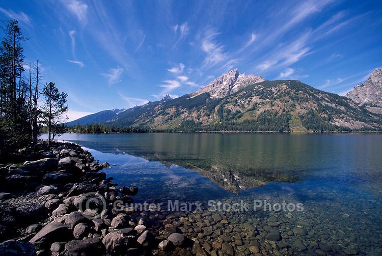 Grand Teton National Park, Wyoming, WY, USA - Grand Teton (Elev 4,197 m / 13,770 ft) and Teton Range Mountains reflecting in Jenny Lake, Summer